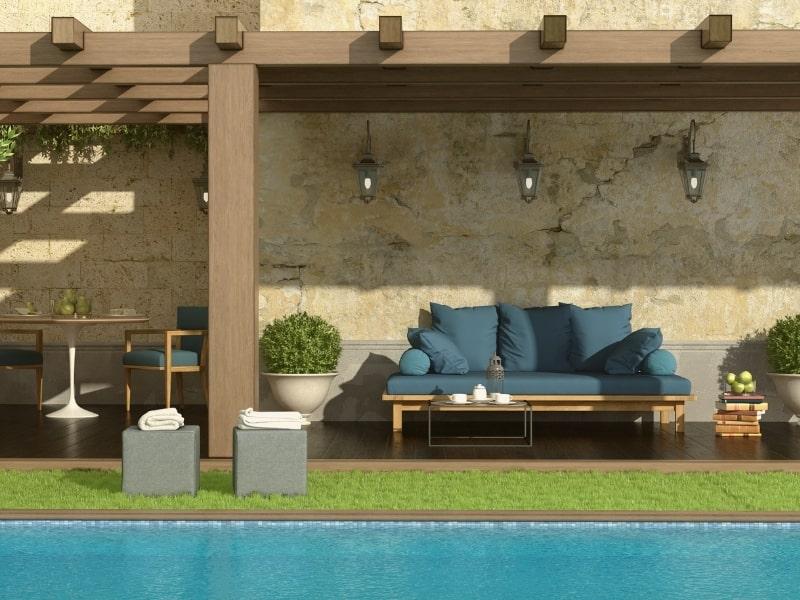 Extension d une maison avec une pergola dans un jardin par un courtier en travaux homy conseil